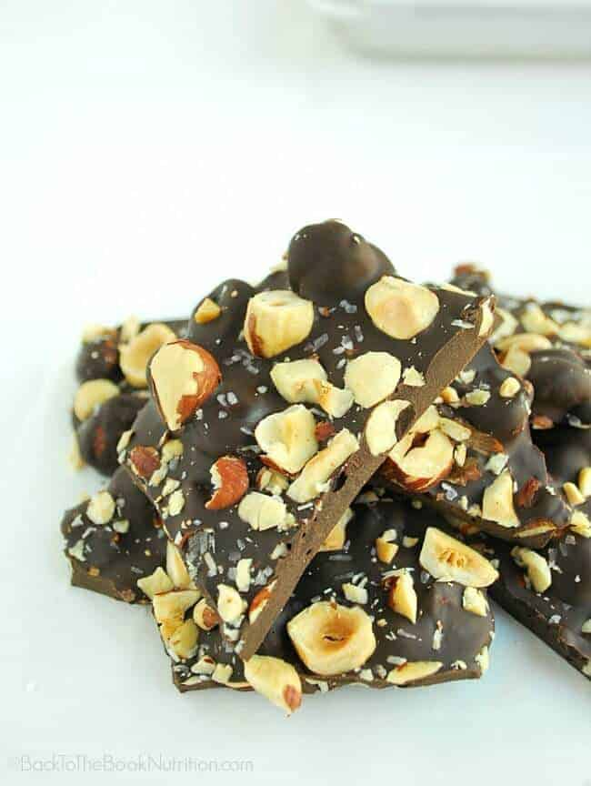 This hazelnut and salted dark chocolate bark has my heart! Just 3 ingredients, super easy to make, and absolutely decadent! | Back To The Book Nutrition